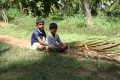 Rural children playing with makeshift toys